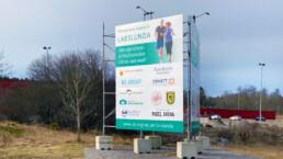 Byggskylt Strängnäs - tillsammans skapar vi Larslunda